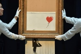 Banksy's cut painting sold for 18 million pounds